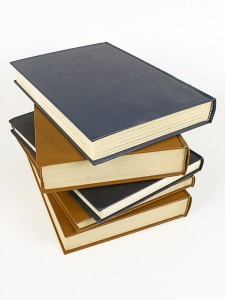 bigstockphoto_Stack_Of_Leather_Bound_Books_1611771